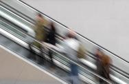 Stock Photo of people on escalator