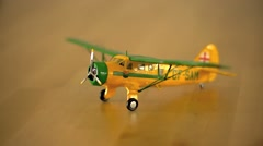 Vintage yellow Toy Airplane side pan Stock Footage