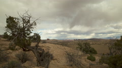 Time lapse view of clouds rolling over dry landscape during day / Moab, Utah, Stock Footage