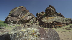 Panning shot of rocky hill in rural landscape / Meadow, Utah, United States Stock Footage