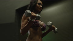 Low angle close up panning shot of bodybuilder lifting weights before Stock Footage