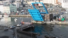 Bright blue drawbridge is lowered on a sunny day in Douglas, Isle of Man Stock Footage