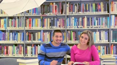 Young students at photoshooting in library Stock Footage
