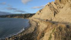 Coastal road next to cliffs prone to erosion Stock Footage