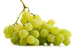 Bunch of fresh white grapes isolated on white background Stock Photos