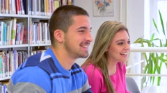Happy students in library Stock Footage