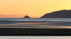 Sunset view of the Waikanae river mouth flowing into the ocean Stock Footage