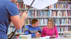Photoshooting in library - stock footage