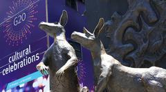 Stock Photo of Kangaroo sculpture next to G20 sign in Brisbane