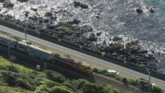 Stock Video Footage of Passenger train and vehicles on motorway side by side along the Kapiti Coast
