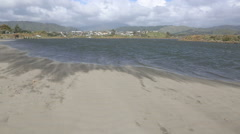 Wind swept sand storm on Waikanae river mouth and beach Stock Footage