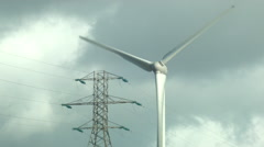Electric Poles and wind turbine in Crosshaven, Ireland Stock Footage