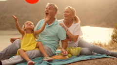 Grandparents and Grandchild in sunset in countryside Arkistovideo