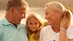 Grandparents and Grandchild in sunset in countryside Stock Footage