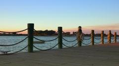 Boardwalk around lake at sunset - stock footage