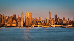 Sunset and Super Moon rising above New York skyline Stock Footage