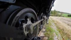Pov view of steam engine train wheels. locomotive background Arkistovideo