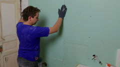 Repairer Make Install Drywall using Screwdriver and Screw Stock Footage