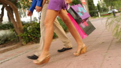 Couple walking with shopping bags - stock footage