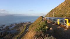 Stock Video Footage of Metro commuter train and traffic on scenic coastal