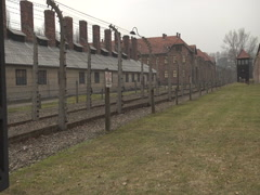 Auschwitz Fence and Building - stock footage