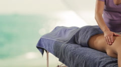 Dolly shot of young woman having massage, sea background Stock Footage