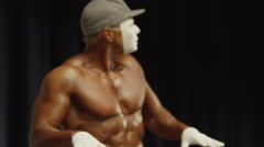 Low angle medium shot of bodybuilder miming on stage at competition / Draper, Stock Footage