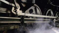 Close up of wheels of steam engine locomotive train Stock Footage