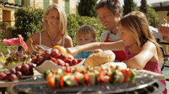 dolly shot of family barbecue - stock footage