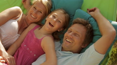 family on garden hammock - stock footage