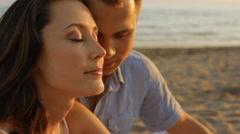 Headshot couple on beach Stock Footage