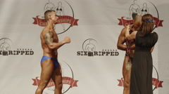 Winning bodybuilders posing on stage / Draper, Utah, United States Stock Footage