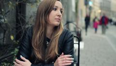 Pensive, thoughtful woman waiting for someone in cafe HD Stock Footage