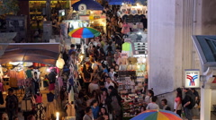 People Walking Through Busy Street Market in Bangkok, Thailand Stock Footage
