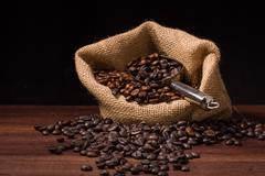coffee beans in burlap sack / coffee beans - stock photo