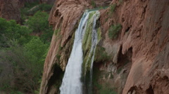 High angle slow motion panning shot of waterfall in rocky landscape / Havasupai, Stock Footage