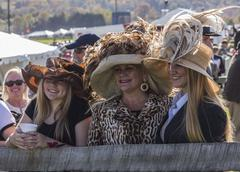 Mother and her young daughters wait for the hat contest Stock Photos