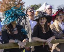 Women wait for the hat contest - stock photo
