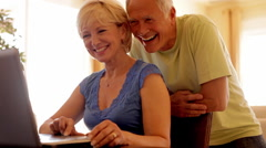 Senior couple using laptop computer Stock Footage