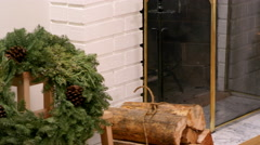 Pan of a fireplace and christmas presents under a tree - stock footage