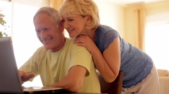 senior couple using laptop computer - stock footage