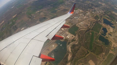 Hyperlapse aerial view as from airplane coming in for landing in Denver, CO Stock Footage