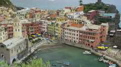 High angle slow motion panning shot of coastal village and boat ramp / Vernazza, Stock Footage