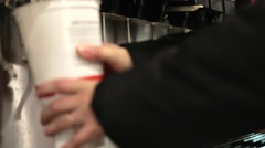 Woman getting soda at fast food Stock Footage