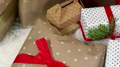 Close up, pan of presents under the tree on christmas morning Stock Footage