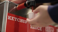 Woman getting ketchup fast food Stock Footage