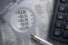 Financial charts. Magnifying numbers. - stock photo