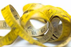 Vintage yellow measuring tape Stock Photos
