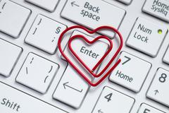 Keyboard love shaped paper clip Stock Photos