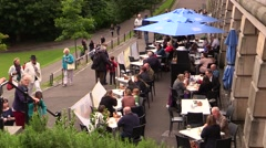 People eating outside the restaurant - stock footage